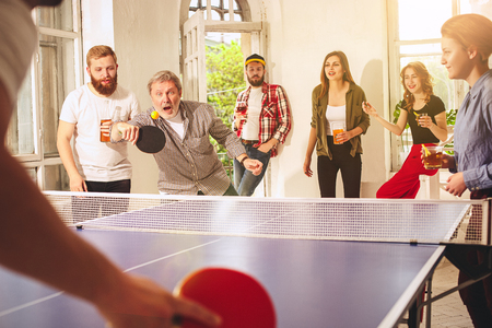 Group of happy young friends playing ping pong table tennis Archivio Fotografico - 101379609