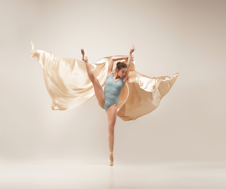 Modern ballet dancer dancing in full body on white studio background. Banque d'images - 101400850
