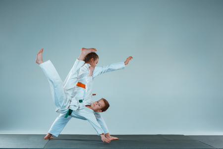 The boy fighting at Aikido training in martial arts school. Healthy lifestyle and sports concept Banco de Imagens - 101432630
