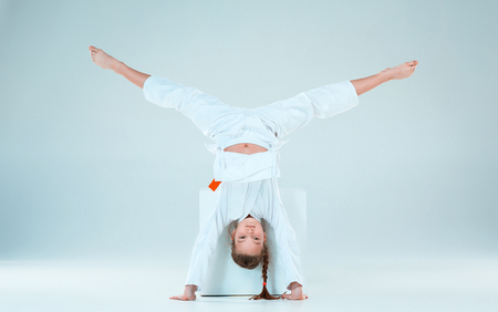 The girl posing at Aikido training in martial arts school. Healthy lifestyle and sports concept Stock Photo