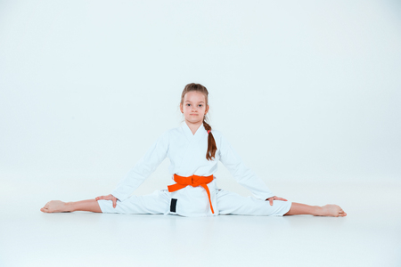 The girl posing at Aikido training in martial arts school. Healthy lifestyle and sports concept Фото со стока