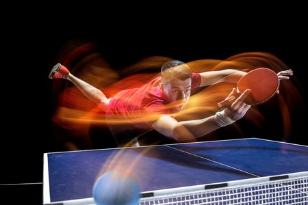 The table tennis player serving Banque d'images