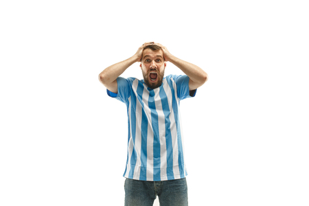 The unhappy and sad Argentinean fan on white background Banque d'images