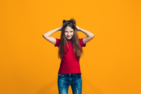 The squint eyed teen girl with weird expression Stock Photo