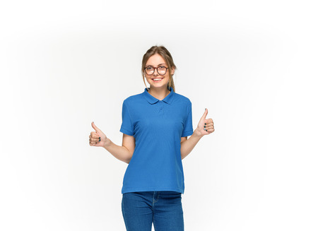 Closeup of young womans body in empty blue t-shirt isolated on white background. Mock up for disign concept