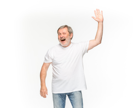 Closeup of senior mans body in empty white t-shirt isolated on white background. Mock up for disign concept