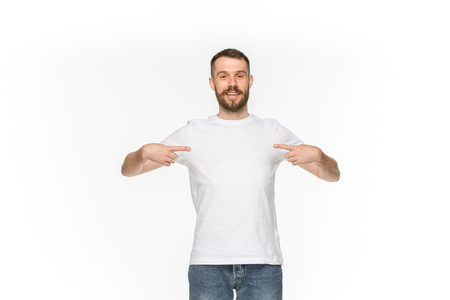 Closeup of young mans body in empty white t-shirt isolated on white background. Mock up for disign concept Standard-Bild
