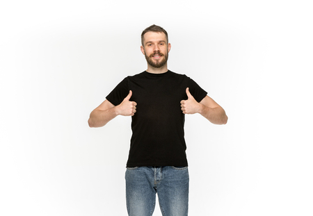 Closeup of young mans body in empty black t-shirt isolated on white background. Mock up for disign concept