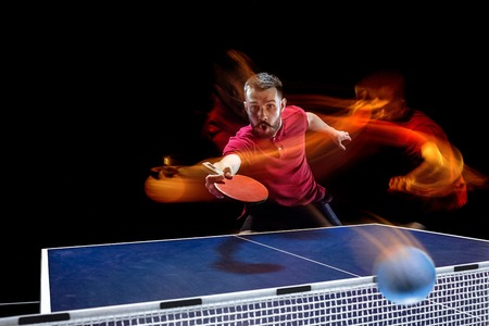 The table tennis player serving Фото со стока