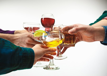 The male and female hands with exotic cocktails