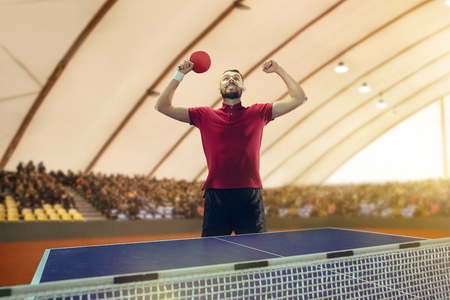 The table tennis player celebrating victory