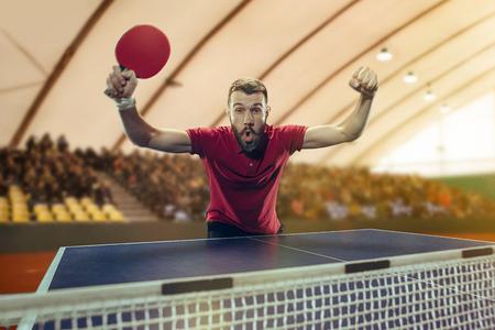 The table tennis player celebrating victory Archivio Fotografico - 102544483