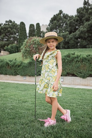 Little girl just swing golf ball on golf course fairway Archivio Fotografico - 102613343