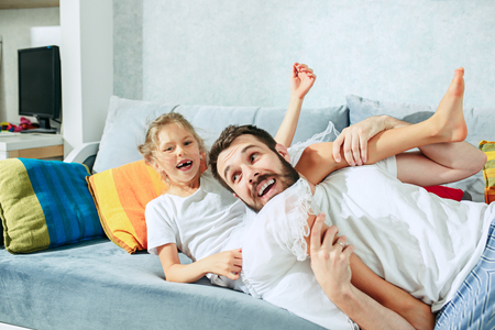 Father and his six years kid girl at home Stock Photo - 102924482