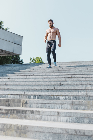 Fit man doing exercises outdoors at city Stok Fotoğraf