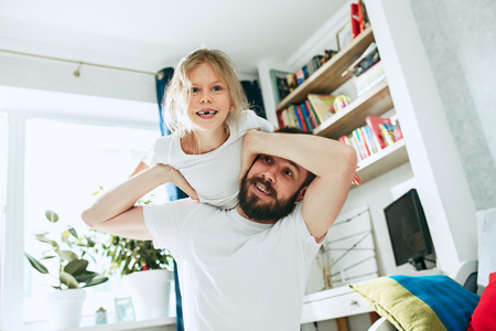 Father and his six years kid girl at home Stok Fotoğraf