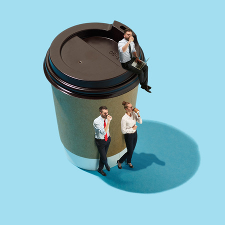 Flat isometric view of businessmen and woman with big cup of coffee 스톡 콘텐츠