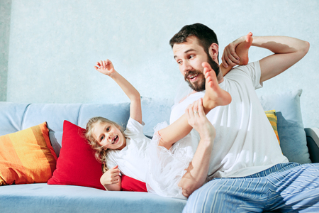 Father and his six years kid girl at home Stock Photo - 103107974