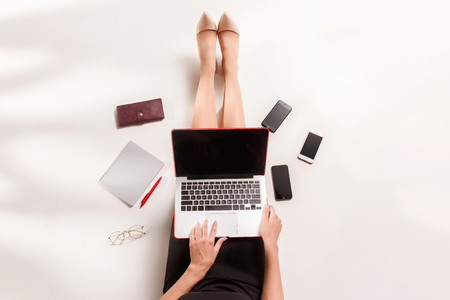 Fashion blogger writing on laptop computer Stock Photo