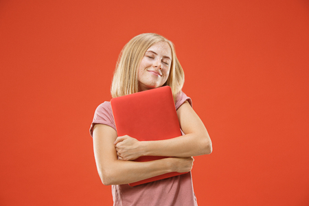 Businesswoman hugging laptop. Love to computer concept. Attractive female half-length front portrait