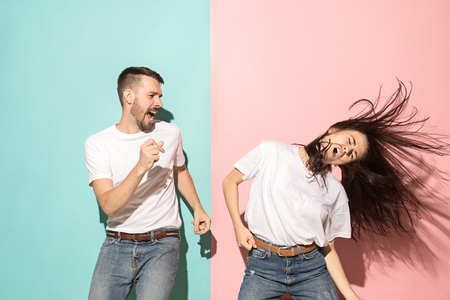 A couple of young man and woman dancing hip-hop at studio. Stock Photo