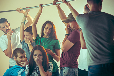 Sweaty armpits. Sweaty man. Bus. Public transport. The unhappy people near man