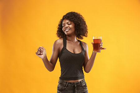 Sexy young afro woman drinking beer, not isolated on white background Banco de Imagens