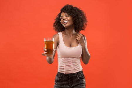 Sexy young afro woman drinking beer, not isolated on white background Reklamní fotografie