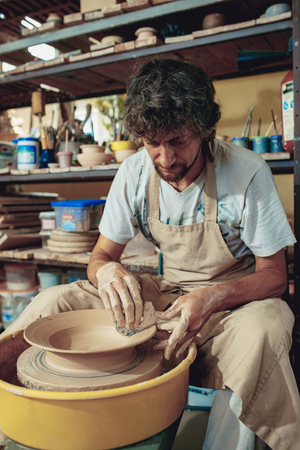 Creating a jar or vase of white clay close-up. Master crock.
