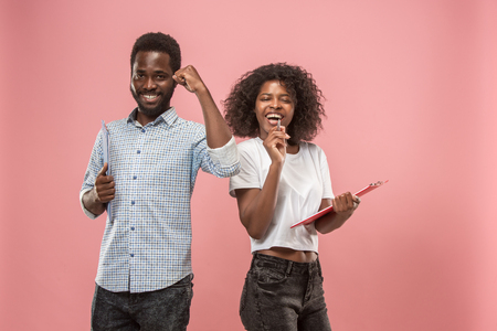 Two african students with folders in t-shirts together. Stylish girl with Afro hairstyle and her boyfriend.
