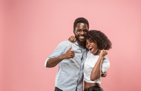 Winning success woman happy ecstatic celebrating being a winner. Dynamic energetic image of female afro model Stock Photo