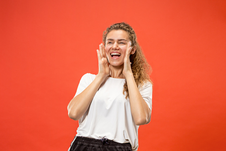 Isolated on pink young casual woman shouting at studio