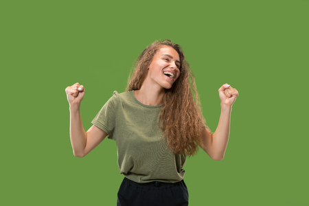 Winning success woman happy ecstatic celebrating being a winner. Dynamic energetic image of female model