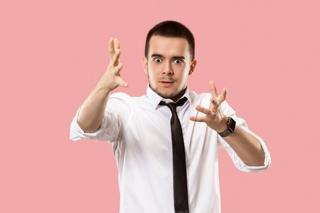 Beautiful male half-length portrait isolated on pink studio backgroud. The young emotional surprised man Stock Photo