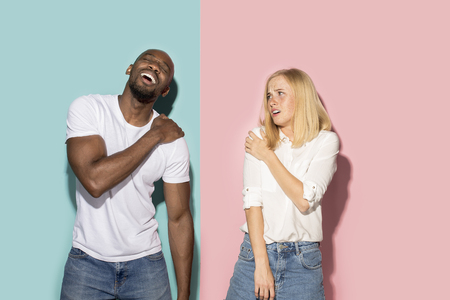Young couple with a pain in the shoulder Stock Photo
