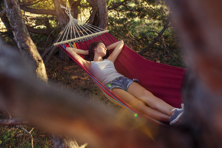 Party, camping. Woman sleeping at forest. She relaxing against green grass. The vacation, summer, adventure, lifestyle picnic concept