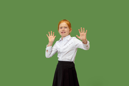 Im afraid. Fright. Portrait of the scared teen girl. She standing isolated on trendy greenk studio background. Female half-length portrait. Human emotions, facial expression concept. Front view