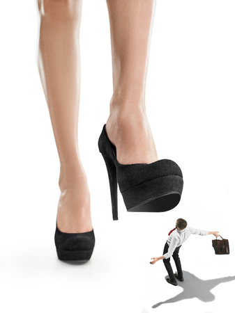 The conceptual collage about lady boss and small man under big female heel. The concept of repression and fear. The concept of female superiority and feminism. business conflict