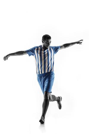 Professional football soccer player in action or movement isolated on white studio background