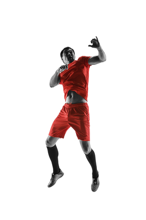 Professional football soccer player in motion isolated on white studio background