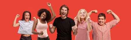 Collage of winning success happy men and women celebrating being a winner. Dynamic image of caucasian male and female models on red studio background. Victory, delight concept. Human facial emotions concept. Stockfoto