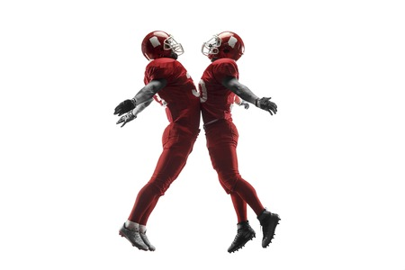 Active two american football player isolated on white background. Fit caucasian men in uniform with ball jumping over studio background in jump or motion. Human emotions and facial expressions concept. scramble concepts