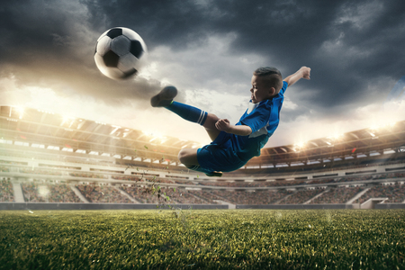 Young boy with soccer ball doing flying kick at stadium. football soccer players in motion on green grass background. Fit jumping boy in action, jump, movement at game. Collage Standard-Bild - 108156494