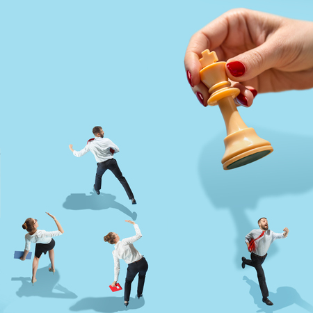 Flat isometric view of businesswoman and male hand with chess figure. Office items concept. Business processes, workplac, human resources concepts. Miniature people. Collage about communications and leadership Stock Photo