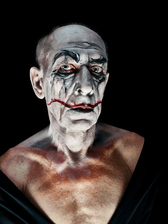 Bloody Halloween theme: The crazy maniak face on dark studio background Stock Photo - 108731888