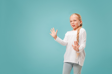 Reject, rejection, doubt concept. Young emotional teen girl at studio rejecting something against blue background. Human emotions, facial expression concept