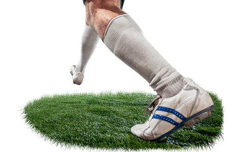 Football playe tackling for the ball over white background. Professional football soccer players in motion on green grass studio background. legs closeup Фото со стока