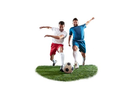 Football players tackling for the ball over white background. Professional football soccer players in motion isolated on white studio background. Fit fighting men in action, movement at game.