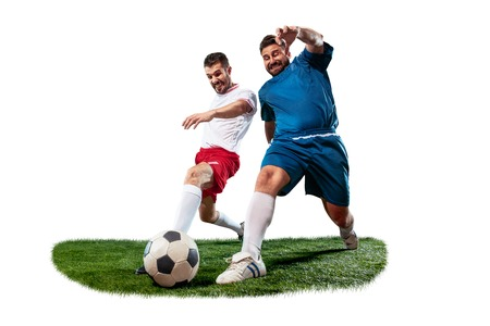 Football players tackling for the ball over white background.