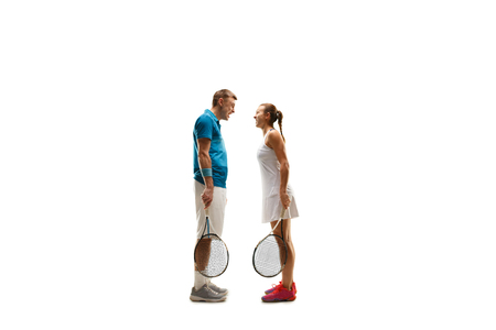 The caucasian couple of male and female tennis players screaming isolated on white background.